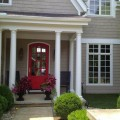 Familiar-Red-Door-with-Chairs-and-Cute-Flowers-Suited-for-Grey-Exterior-House-Paint-Ideas-and-Glass-Ventilations-for-Home-Inspiration-835x626